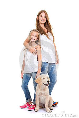 Kids with golden labrador, retriever puppy