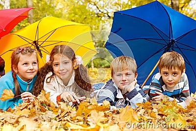 Kids group under umbrellas