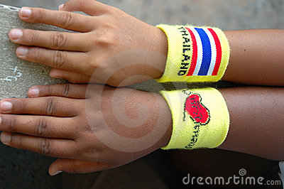 Kids  hand with Thailand wristband