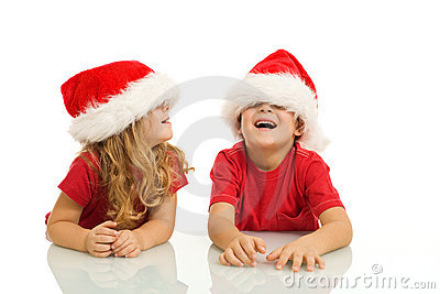 Kids having fun with christmas hats