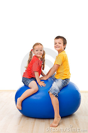 Kids having fun playing with a large ball