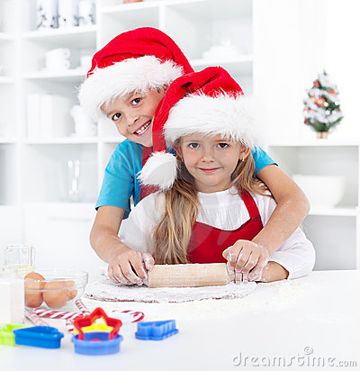 Kids having fun preparing christmas cookies