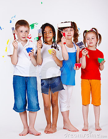 Kids holding paintbrushes and paints