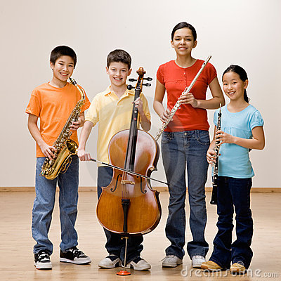 Kids holding saxophone, cello, flute and clarinet