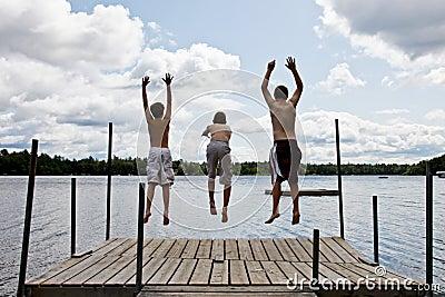 Kids jumping into Lake