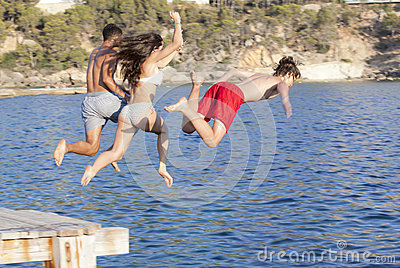 Kids jumping in ocean