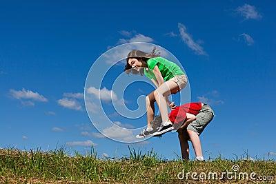 Kids jumping outdoor