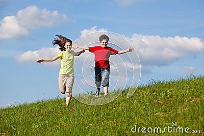 Kids jumping, running outdoor
