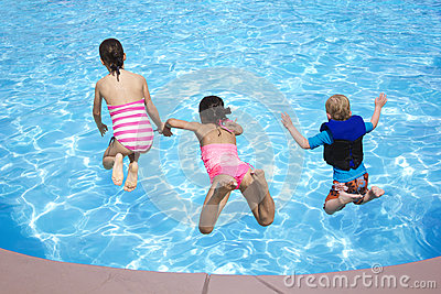 Kids jumping into the Swimming Pool