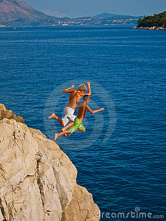 Kids jumping in the water Editorial Photography