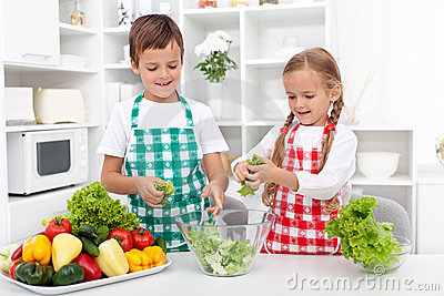 Kids in the kitchen preparing salad