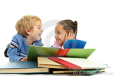 Kids laying down and reading a book