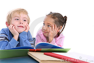 Kids laying down and reading books