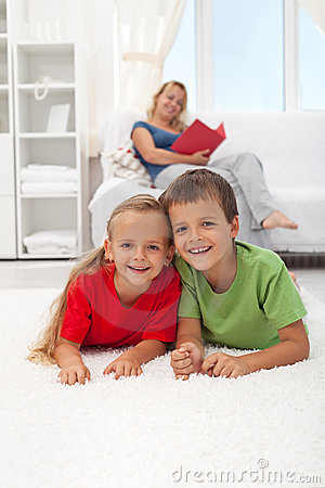 Kids laying on the floor in the living room
