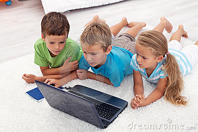 Kids looking at laptop computer