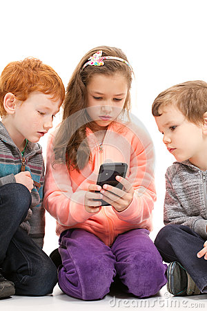 Kids looking at smartphone