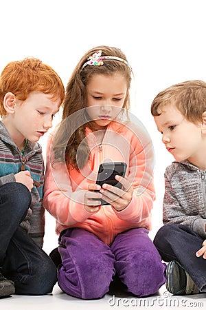 Kids looking at smartphone