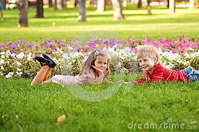 Kids love concept. Little couple in love outdoor