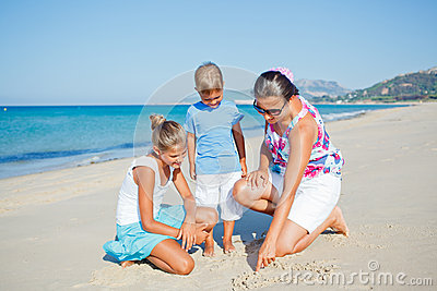 Kids and mother on the beach