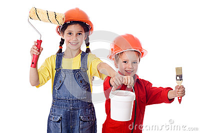 Kids in overalls with paint roller and paintbrush