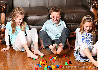 Kids pickup up blocks with feet