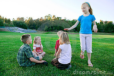 Kids play duck duck goose