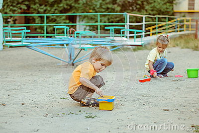 kids play in the sand box