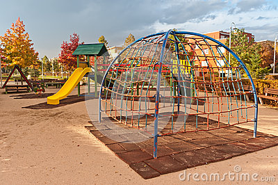 Kids playground in urban autumn park