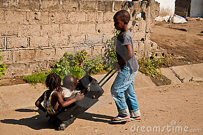 Kids playing in Africa Editorial Stock Photo