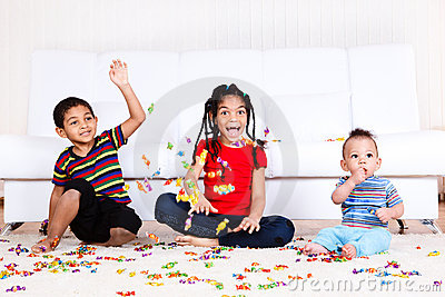 Kids playing with candies