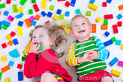 Kids playing with colorful blocks Stock Photo