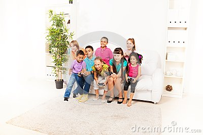 Kids Playing Computer Games Together Stock Photo