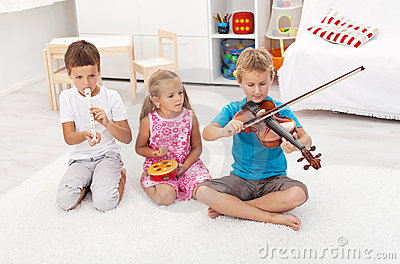 Kids playing on different musical instruments