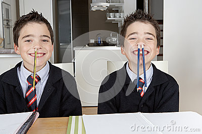Kids playing while doing homework at home