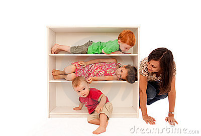 Kids playing hide and seek with mum