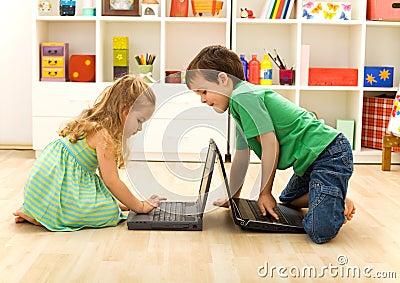 Kids playing on laptops