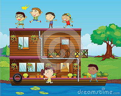 Kids playing near a houseboat