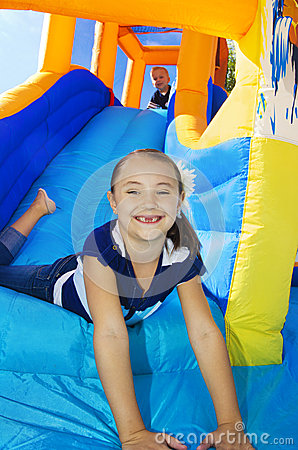 Free Kids Playing On An Inflatable Slide Bounce House Royalty Free Stock Image - 26941576