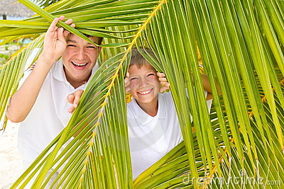 Kids playing in palm leaves