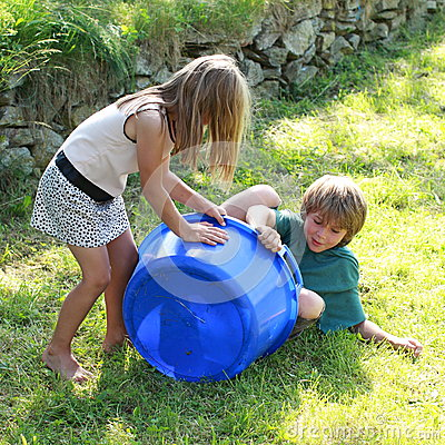 Kids playing with a pock
