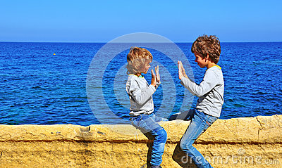 Kids playing at the sea