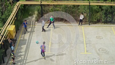 Kids playing soccer on urban parking stock video