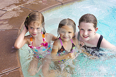 Kids playing in the swimming pool together