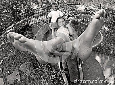 Kids playing in wheelbarrow