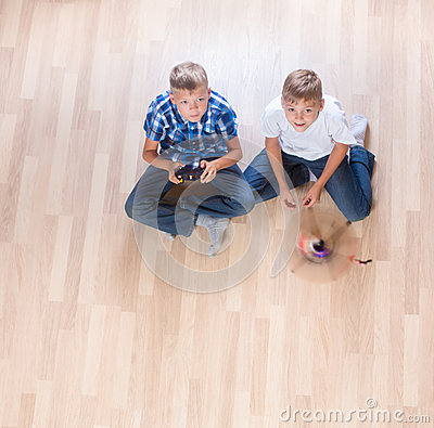 Free Kids Playing With Flying Helicopter Model At Home Using Remote Control Stock Photo - 76942850