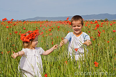 Kids on poppy field