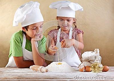 Kids preparing a cake