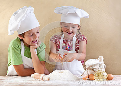 Kids preparing the dough for a cookie