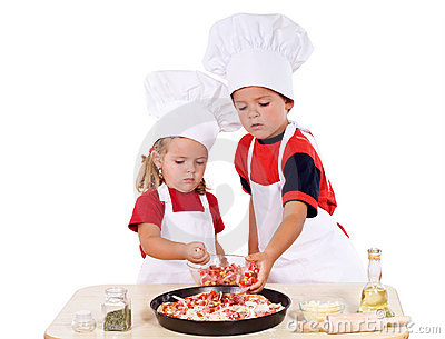 Kids preparing pizza