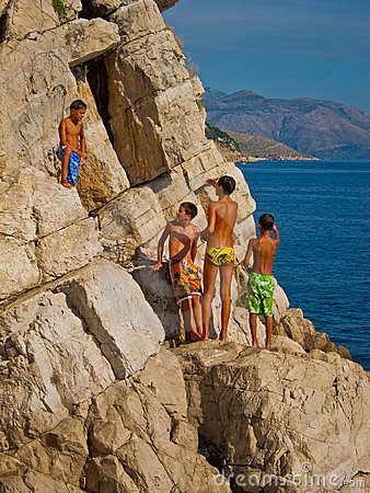 Children climbing up for a cliff dive Editorial Photography